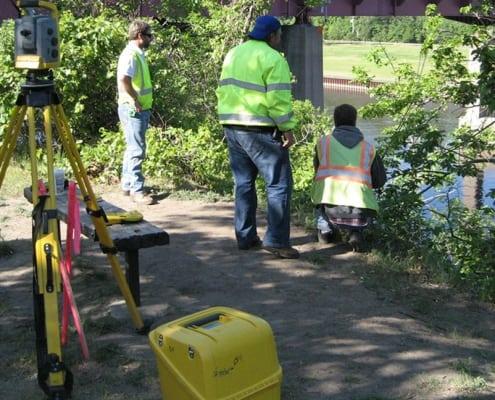 Three Surveyors on Washington Avenue Bridge Minneapolis Minnesota